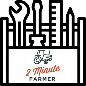 Icon of a toolbox containing a spanner, screwdriver, ruler and pencil. With the 2 minute farmer logo on the front